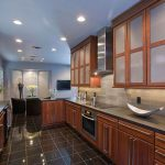 Cherry european cabinetry with glass doors